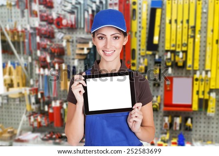 Portrait Of Young Female Worker Holding Digital Tablet