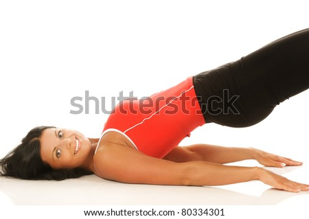 Portrait of young fitness woman lying during workout. - stock photo