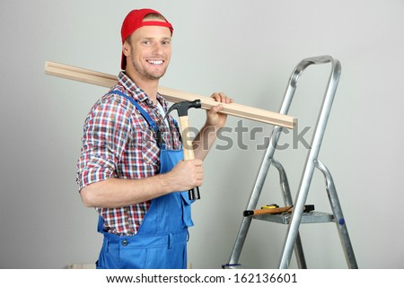 Portrait of young foreman in room - stock photo