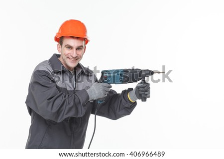 Portrait of young foreman in white room drill work - stock photo