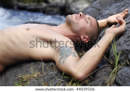 Portrait of young french man sleeping on rock