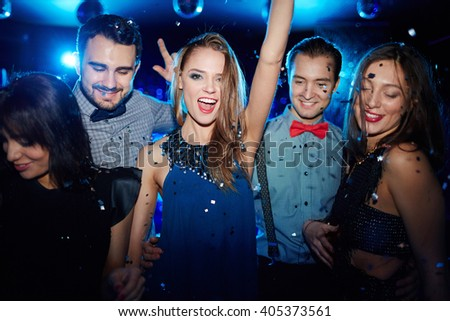 Portrait of young friends in nightclub