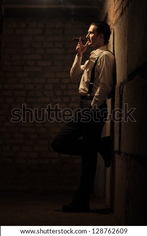 Portrait of young gangster with cigar - stock photo