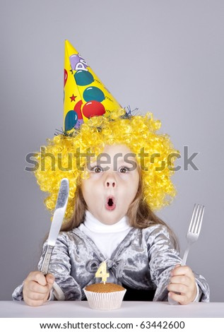 Portrait of young girl at birthday with cake. Studio shot.