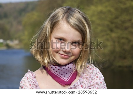 Portrait of young girl at sunset - stock photo