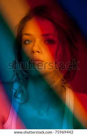 Portrait of young girl behind the color filters - stock photo