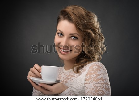 Portrait of young  girl brown hair drinking coffee  - stock photo