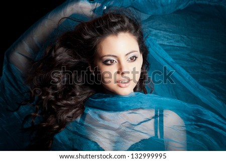 portrait of young girl dancing with long textile - stock photo