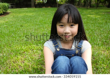 Portrait of young girl having a good time in the park - stock photo
