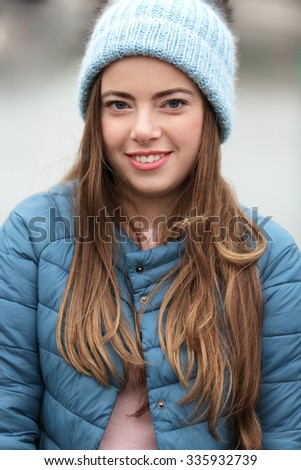 portrait of young girl in autumn clothes - stock photo