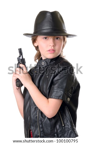 Portrait of young girl in black hat with a gun