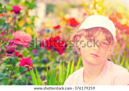 Portrait of young girl in garden. Toned image - stock photo