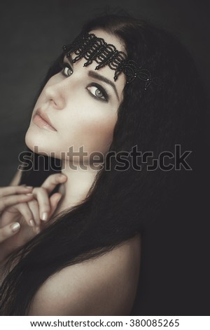 Portrait of young girl in gothic dress with black necklace - stock photo