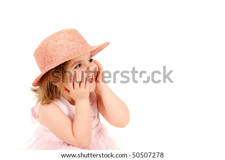 Portrait of young girl in pink princess dress and hat laughing, studio shot - stock photo