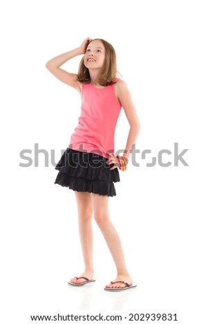 Portrait of young girl looking surprised. Full length studio shot isolated on white. - stock photo