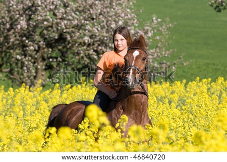 Portrait of young girl on sorrel horse