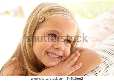 Portrait Of Young Girl Relaxing On Sofa