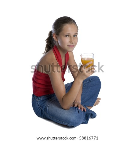Portrait of young girl sitting with glass of orange juice, studio shot isolated on white background - stock photo