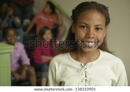 Portrait of young girl smiling - stock photo