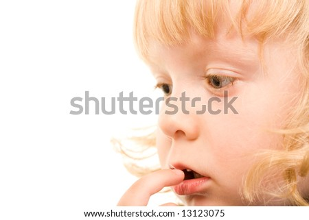 Portrait of young girl touching her mouth by finger - stock photo