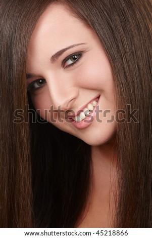 Portrait of young girl with beautiful straight hair - stock photo