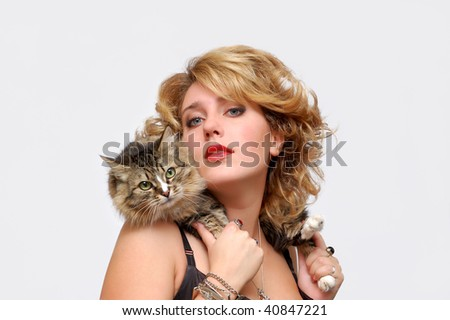 Portrait of young girl with cat over white - stock photo