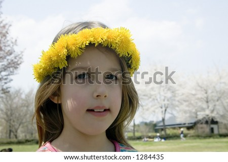 Portrait of young girl with dandelions against chery blossom, Japan