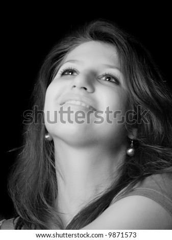 portrait of young girl with happy smile over black