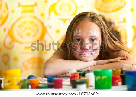 Portrait of young girl with paint of face. - stock photo