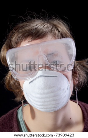 Portrait of young girl with protective mask and glasses