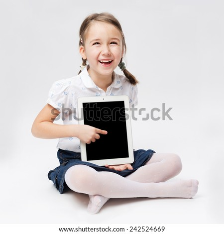 Portrait of young girl with tablet - stock photo