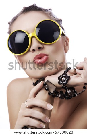 Portrait of  young gorgeous woman in funky yellow sunglasses - stock photo