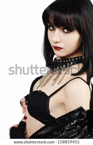 Portrait of young goth woman on white background - stock photo