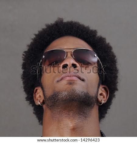 Portrait of young handsome african male with sunglasses - stock photo