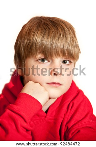 Portrait of young handsome boy wearing red hooded top against white background - stock photo