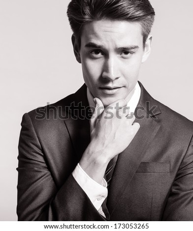 Portrait of young handsome business man - stock photo