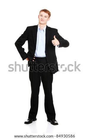 Portrait of young handsome businessman, gesturing OK