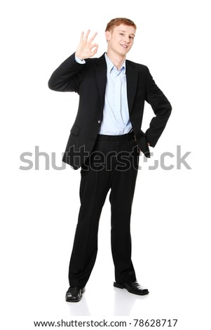 Portrait of young handsome businessman, gesturing perfect