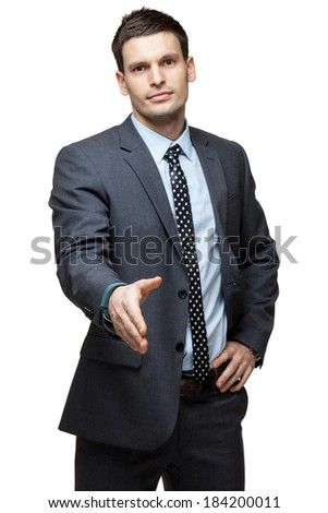 Portrait of young handsome businessman. Giving a hand. Isolated on white. - stock photo