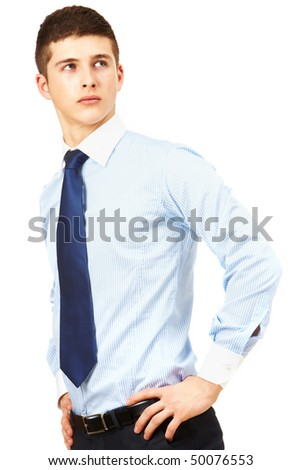 Portrait of young handsome businessman looking aside in isolation