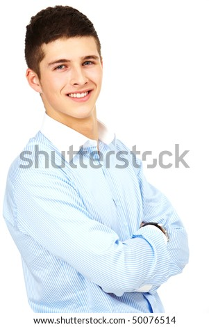 Portrait of young handsome businessman with crossed arms looking at camera - stock photo