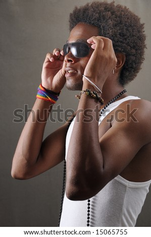 Portrait of young handsome latino man wearing sunglasses - stock photo