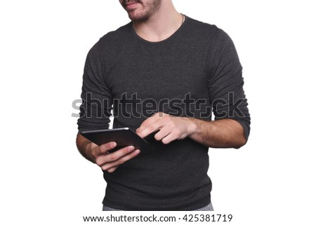 Portrait of young handsome man using tablet. Isolated white background.