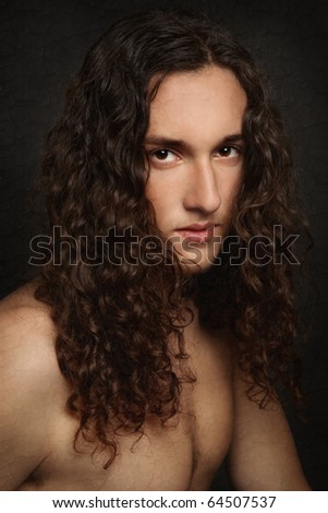 Portrait of young handsome man with beautiful long curly hair, styled as old painting with damaged craquelure background - stock photo