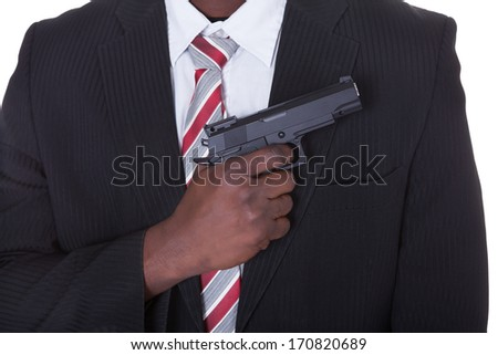 Portrait Of Young Handsome Man With Gun - stock photo