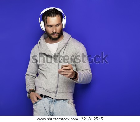 Portrait of young handsome man with headphones - stock photo