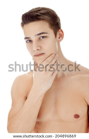 Portrait of young handsome man with health clean skin touching his chin isolated on white background - stock photo