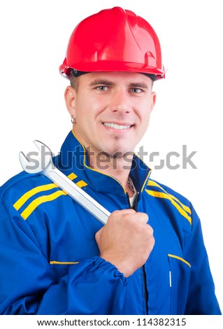 Portrait of young handsome mechanic with hard hat and in overalls holding wrench isolated on white.