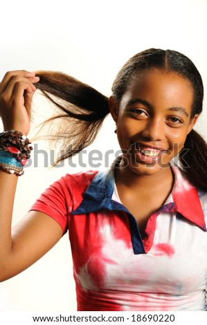 Portrait of young happy african american girl smiling - stock photo