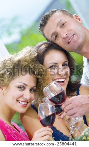 Portrait of young happy attractive people having some wine